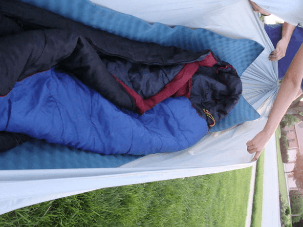 Camping Hammock with foam sleeping pad and sleeping bag. Photo uploaded to instructables.com by user larslovespeace