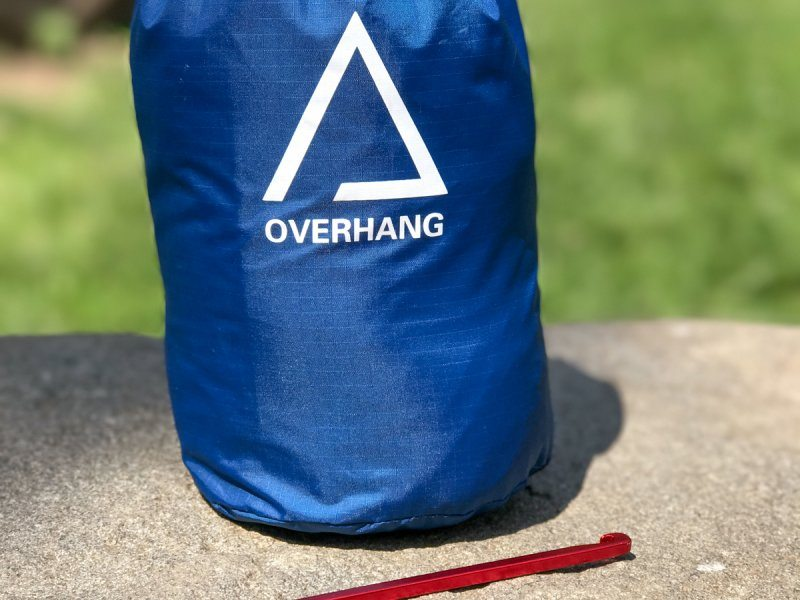 Serac overhang lightweight raintarp in stuff sakc with guy lines, ridgelines, stakes and carabiners rainfly